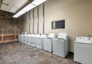 Laundry Area At City Lofts on Laclede